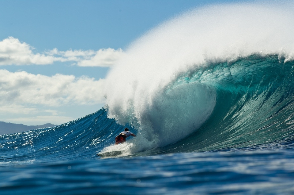 Stealing a moment away from his larger role in his family's life on Kauai, Bruce Irons found himself  in a world of his own in the barrel at Backdoor today; so much so that he had no idea that his only real score - a nine - was the best wave ridden in his heat.