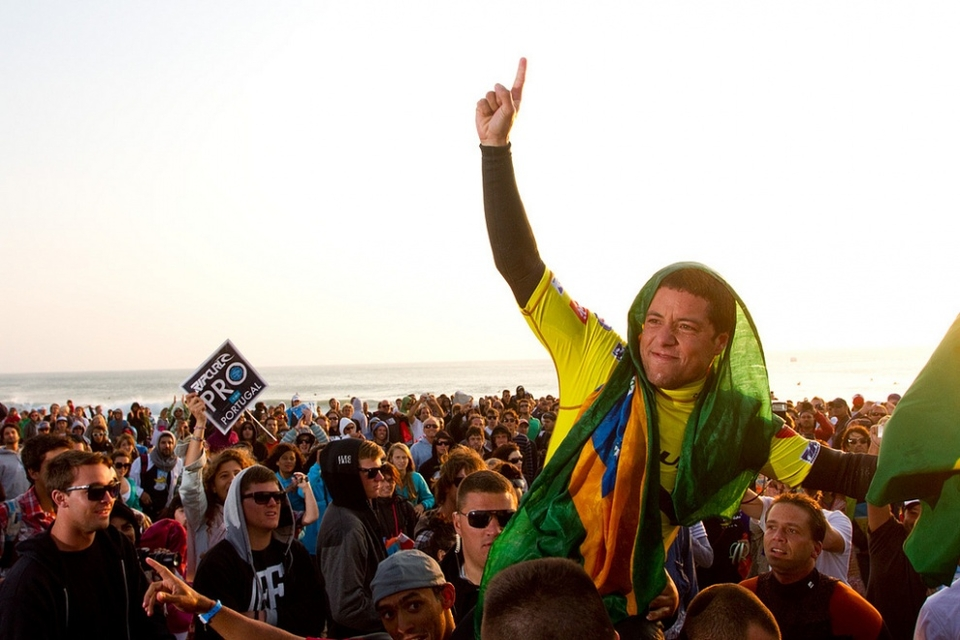 ADRIANO de Souza crowns Kelly Slater after beating the champ to the top the podium at the  Rip Curl Pro  Portugal, much to the delight of the locals.    All hail the waves, the creating storm, the sand, and the surfers slipping through flawless hoops from dawn till dusk. Hail the king, stomping on the fingers of another young pretender.      Congratulations must also extend to Adrian de Souza, Rip Curl Pro Portugal winner in a slow final over Kelly. But here in Portugal Slater was the real winner, his final a truncated shadow boxing comp against Owen Wright, whose Rd3 knockout eliminated him from the title race.  Adriano bowed down and saluted Kelly on the podium as the 11 times world champion and acclaimed him as his inspiration to get to number one.
