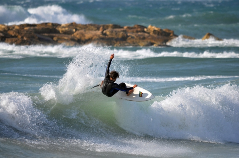 Amit Niv, fins-free foam whip at Dolphinarium. A spot still ridable in a strong southerly wind.
