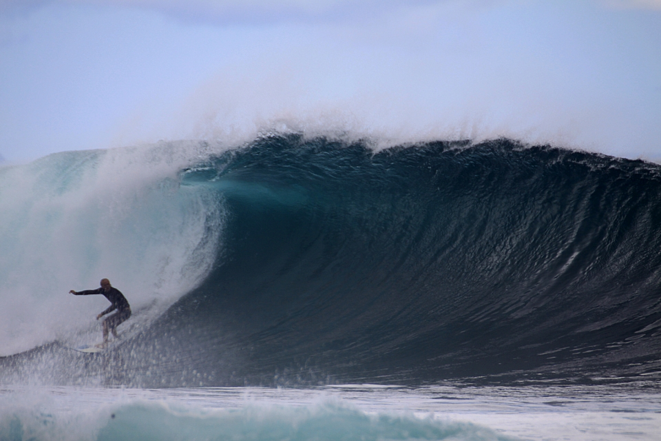 This is a wave that could easily be mistaken as Pipeline for power and appearance.  Julian finding his rail in this bomb.