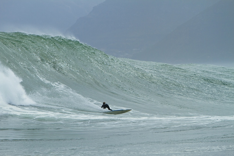 John Farrel looking for the barrel on another perfect left.