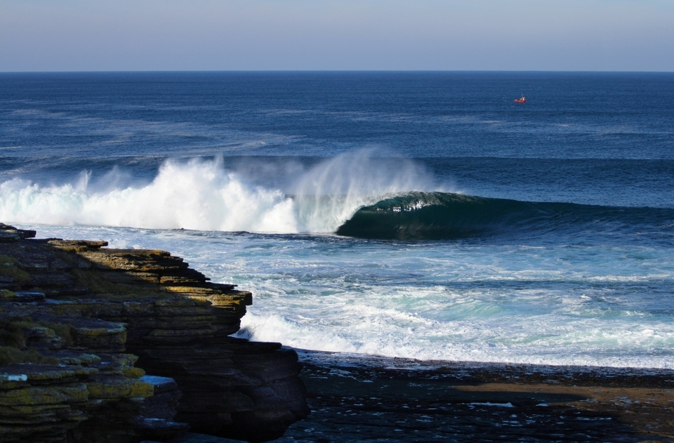 Shallow, heaving, Scottish reefbreak close to Thurso by Will Bailey.
