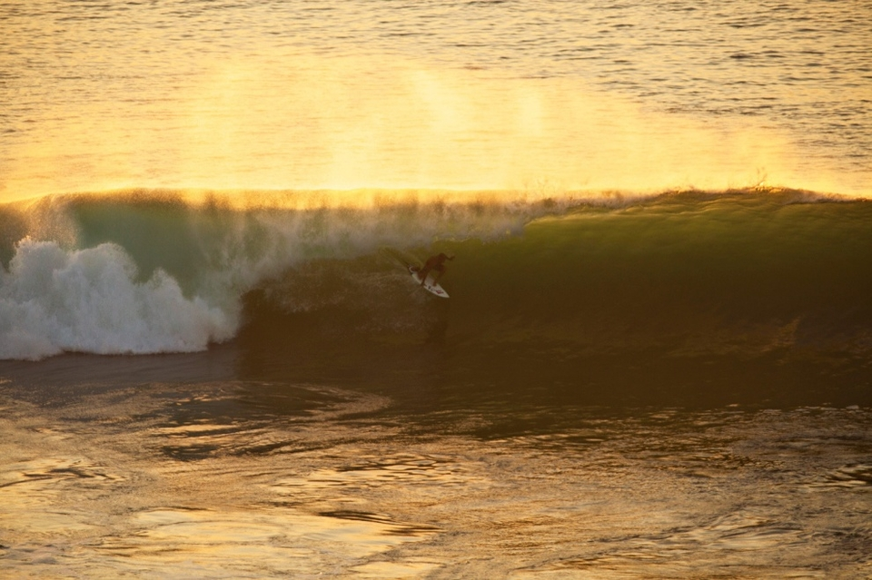 Kelly Slater and Rizal Tanjung paddled out at Padang Padang before dark during the peak of the swell on Friday. The crowds were content to sit on the shoulder and watch them pick off the best set waves. Here's Kelly mining the afternoon gold.