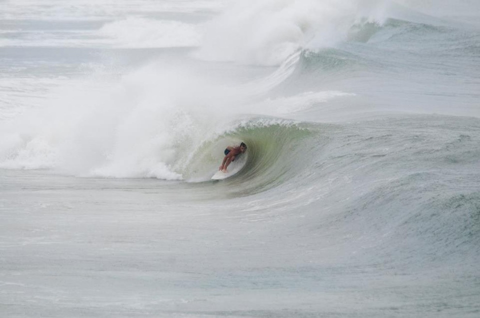 Fluid Surf Shop team rider, Pete Berkey shacked in a perfect little curler.