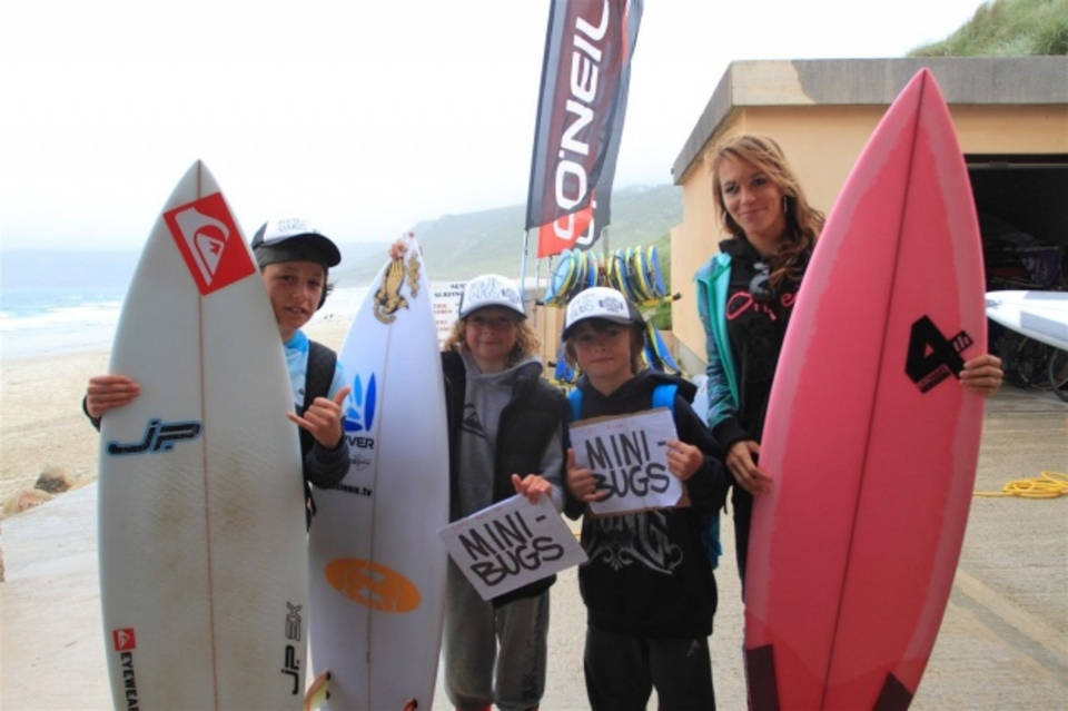 Celine Gehret with the division winners who each won a surfboard