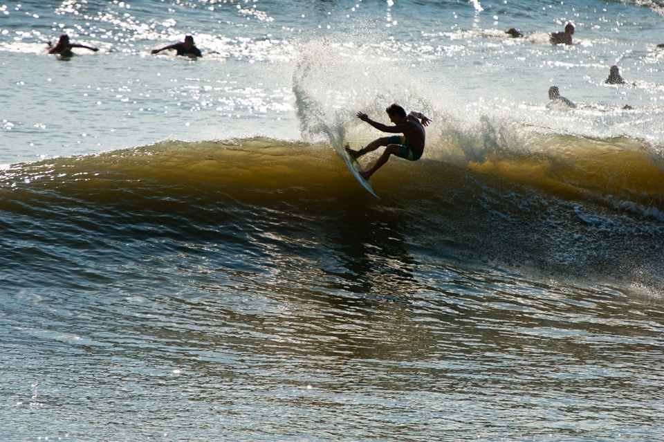 In the past couple of years our sandbars have really changed. What used to be a high tide break, the Jax Beach Pier, has morphed into a low tide spot. Adam King carves his way through a solid outside bowl as the tide starts to fill in.