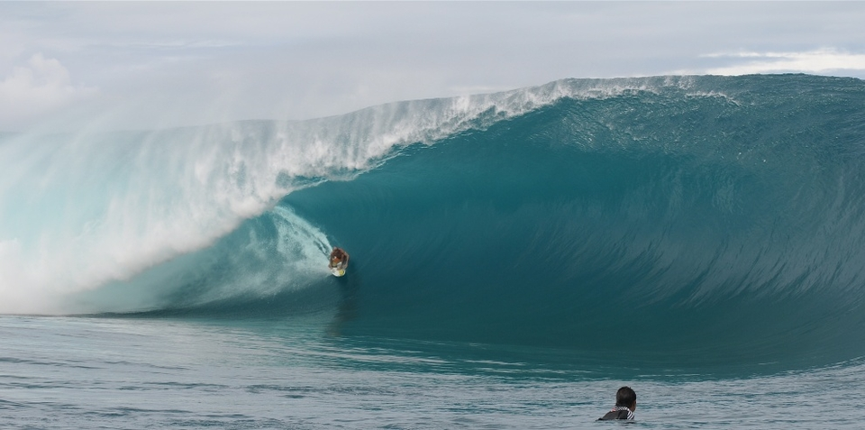 Shane Dorian on a Teahupoo bomb during the recent mega swell, captured by project-photography.