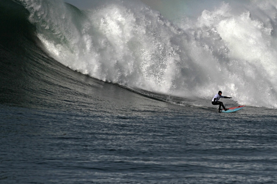 Jamie Sterling bottom turning his big wave sled like a standard thruster.