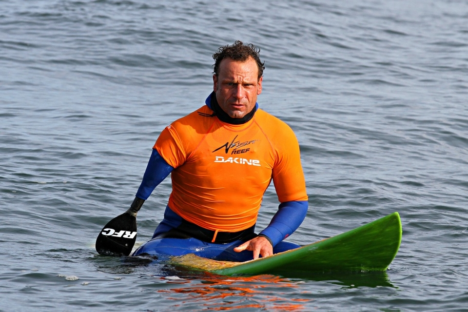 Jeff Denholme probably doesn't want to be lauded for paddling a big wave event with only one traditional arm, but we're impressed Jeff.