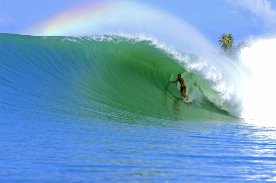 San Diego surfer Phil Goodrich in a perfect Lagundri Bay barrel.    An old favourite which  Paul Kennedy  is reviving through POD. An iconic image which by rights should grace many a wall.