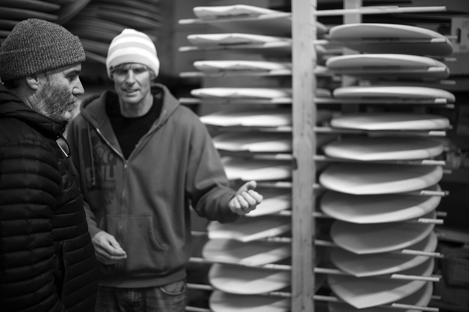 Mike and Biolos talk inner machinations at the factory.