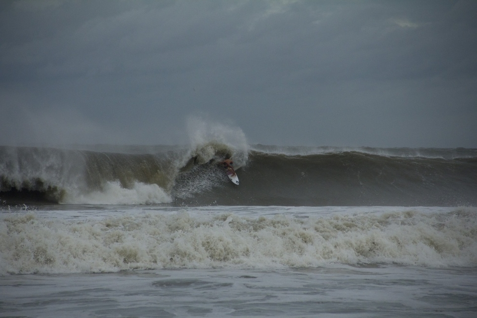 Kyle Busey getting critical on a large left at Folly Pier.   More  here