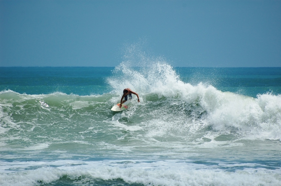 Tommy Milbourne enjoying the swell at Satellite Beach, Florida.   More  here