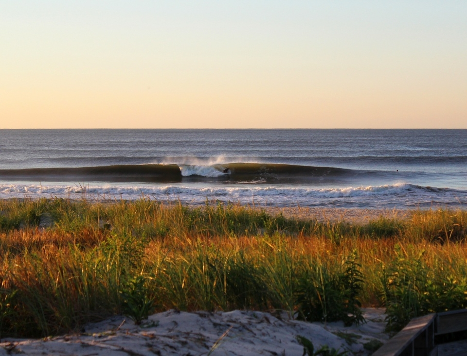 September in New York. Clean, crisp and cool air with fun Leslie waves. Unknown surfer pulls in.