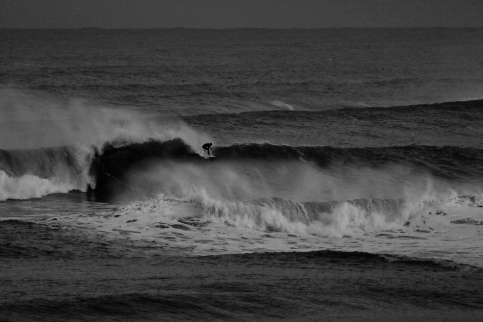 Your humble author James getting one of the same sort of set waves which cleaned up Rob just inside, in near darkness. Moving in to the 1st person here, I can tell you that this was the bumpiest and most difficult to surf 6ish footer I have ever ridden. Myself and another Welsh lad Rhod rode the 'other wave' at this spot and were roundly frustrated, neither of us getting a good one in 2 hours & having to constantly paddle. The epic tide was delivering nothing short of an epic rip and chop.
