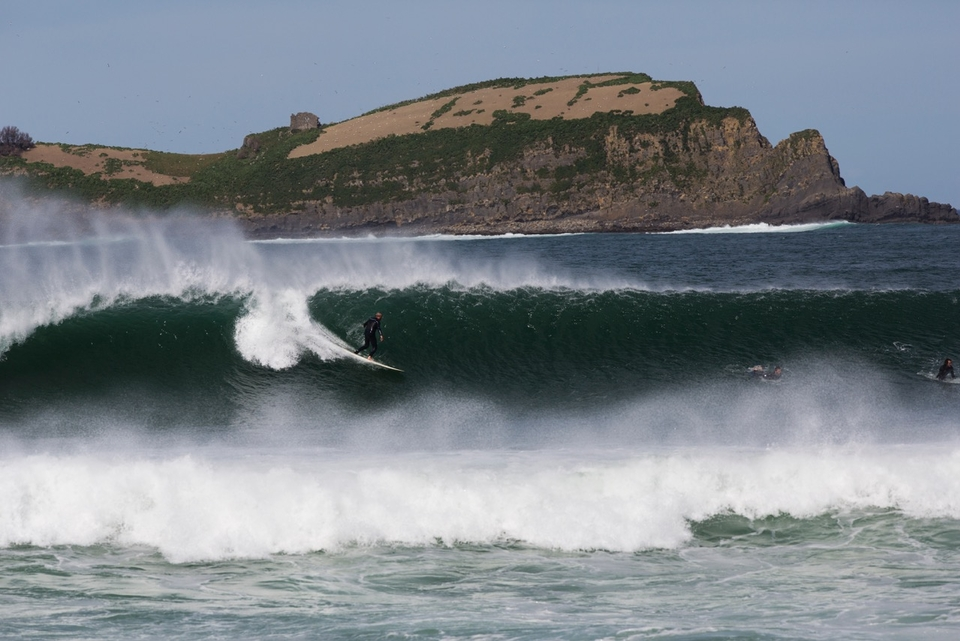 A Mundaka ripper takes one of the larger waves of the day.