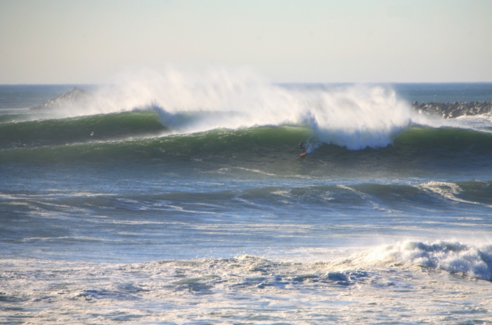 Don't be lured in by the A-frames and acres of open face. This spot can deal out a solid beating and many were received on Monday. Rich Gibson picks off a bomb.