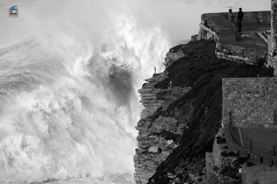 Nazare, Portugal. . Their conversation must have been pretty engrossing, or perhaps the Portuguese have simply grown accustomed to humongous storms.