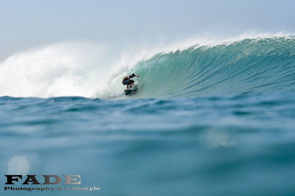 Puerto Sandino, Nicaragua.  Surf camp owner, Raphael Sterza, hard at work in Nicaragua.