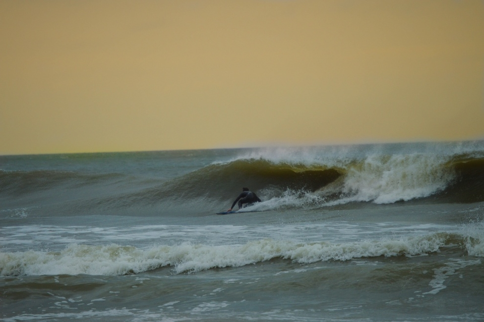 One of the many riders keen to make the most of the quick swell before it disappeared