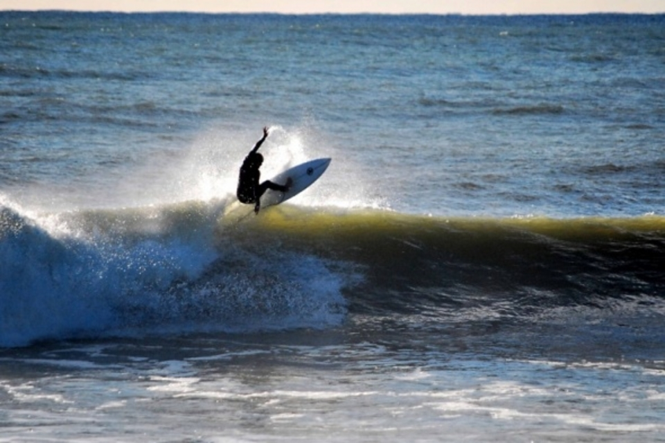 One of those days when even the surfer is performing ... Spiderman impression