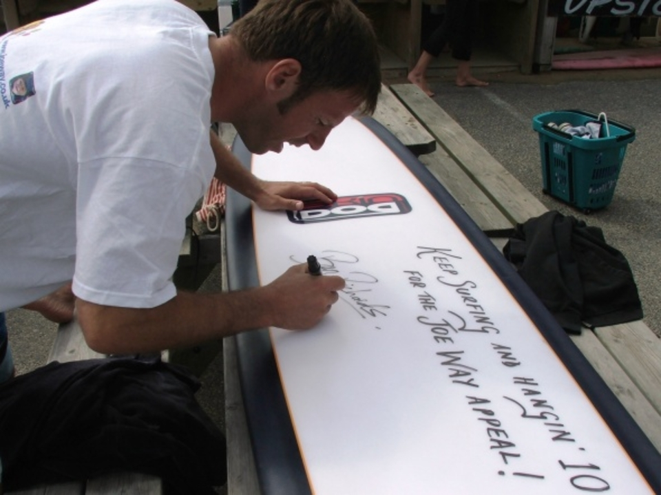 Ben Richards signing the concept board