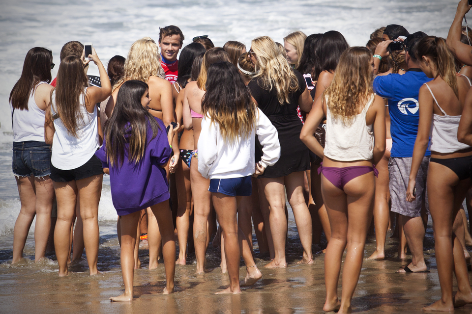 What do you think attracted defending event winer and millionaire surf stud, Julian Wilson, to the same sandy spot as all those girls?