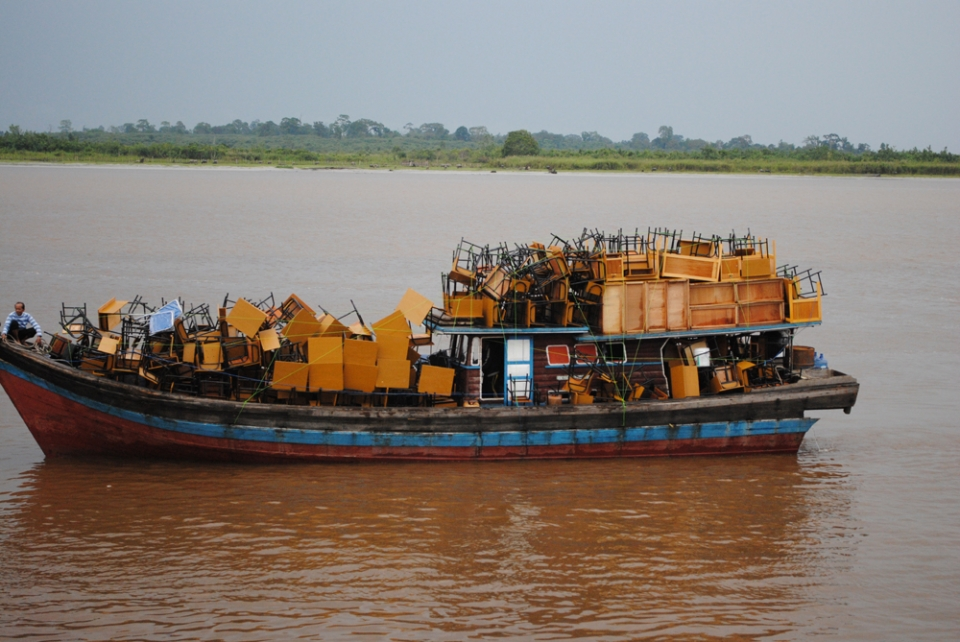 One of the ubiquitous furniture boats which navigate the local waters.