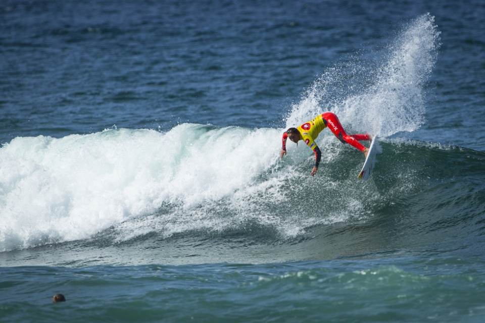 The event winner and World Champion, Carissa Moore, cutting off the top on the final day.