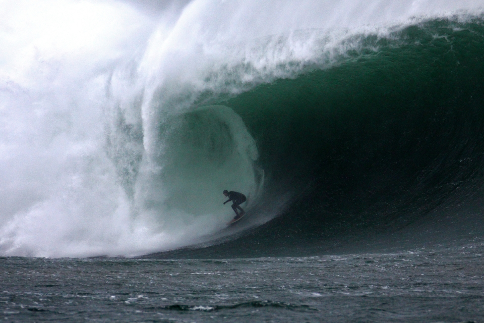 Neil Britton charging through a cavern during the final session of an epic three day swell.