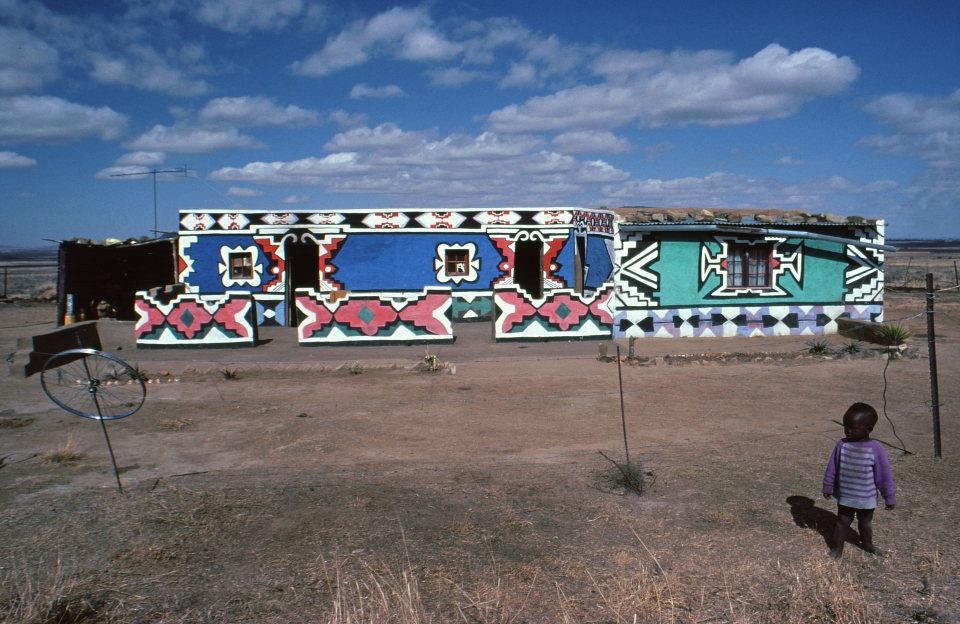 African huts decorated in the Ndebele art of Northern Kwazulu, if you go deep enough, this kind of sight will greet you on your way towards many uncrowded and perfect waves.