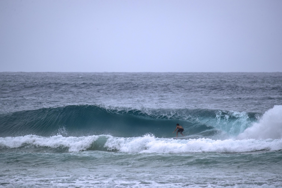"Davey van Zyl sets up for one of the few, ""perfect"" tubes during cyclone Idai which stayed wide and open from start to finish."
