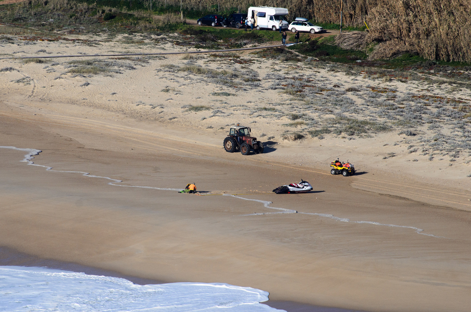 Not the first time we've seen a beach-side CPR scenario at Nazare.  Thankfully this time he walked away and made a full recovery.