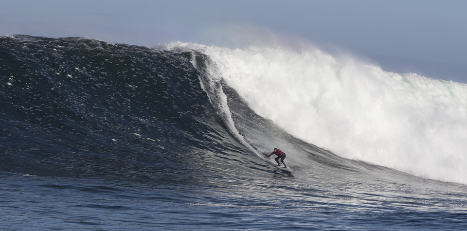 Simon Lowe on an amazing looking wave from way out the back.
