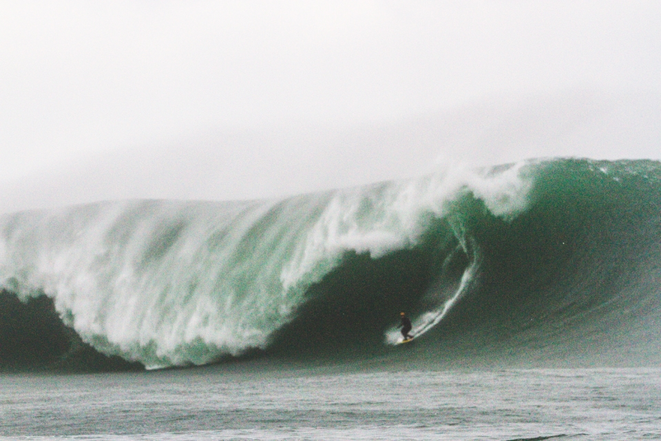 Dylan scooping off the bottom on a windswept giant. Frame 1 of 3.