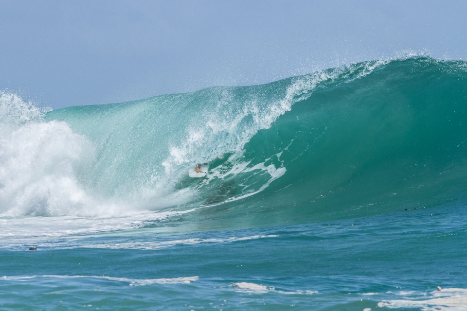 When the wind changed, Luke Saranah moved to a secret spot. After getting the barrel of the day at Silverbacks, he got the barrel of the day again. The photo is no illusion; the tube gets bigger as the wave wraps around.