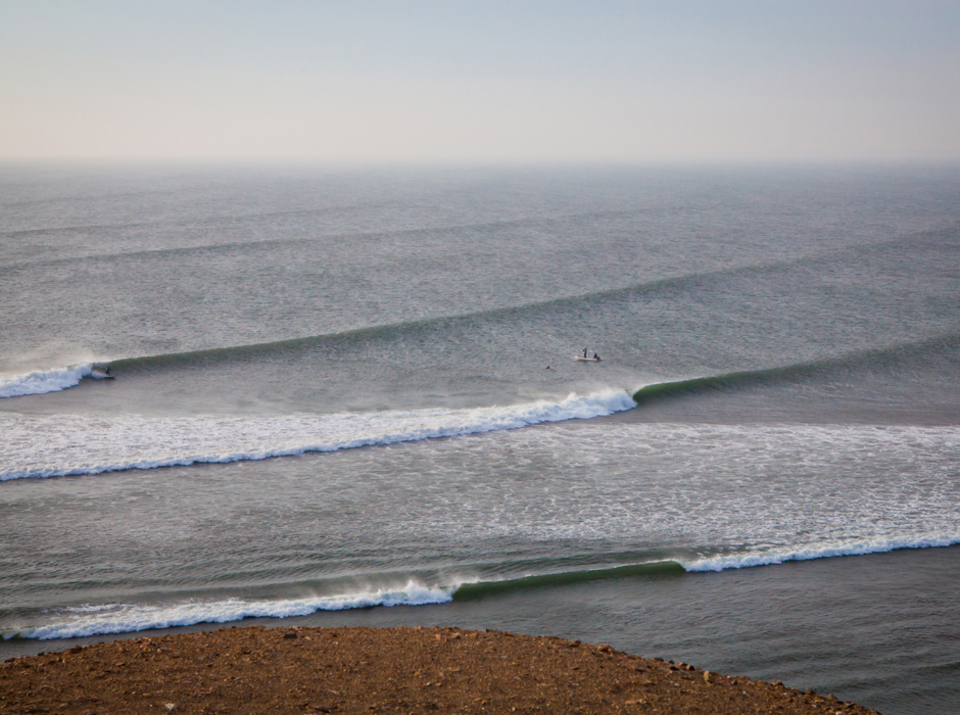 A lucky surfer heads towards the hollow El Hombre section.