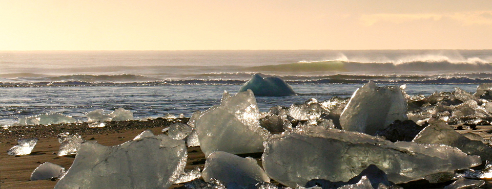 Oversized ice cubes then drift out to sea and along the beach, like a scattering of oversized diamonds in the sand.