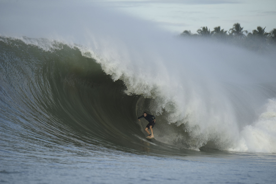 Big Wednesday, Laurie Towner wrangling near impossible Nias.