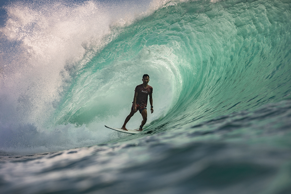 """I shoot with a Canon 5d mark 4, 15mm fisheye, 16-35mm, 50mm 1.2, 70-200mm and 150-600mm. In the water it's a Liquideye waterhousing. I think you owe it to great surfers to use great equipment. Just like they are. Then there is a trust between the both of you. And then you get shot like this with Mega Semadhi stalling and calm where most surfers would be screaming to just survive. In this shot, Mega reminds me of a hunter letting the lion get real close before raising his rifle. Taking that time to express your nerve."
