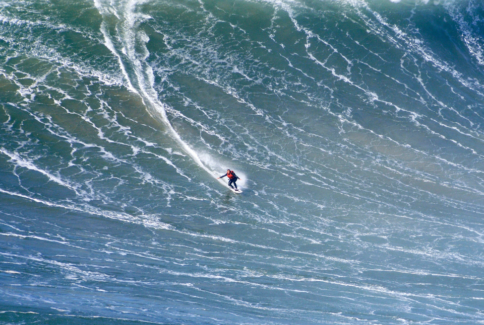 Nuno's been surfing giant Nazare for years, such as here, sans violin.