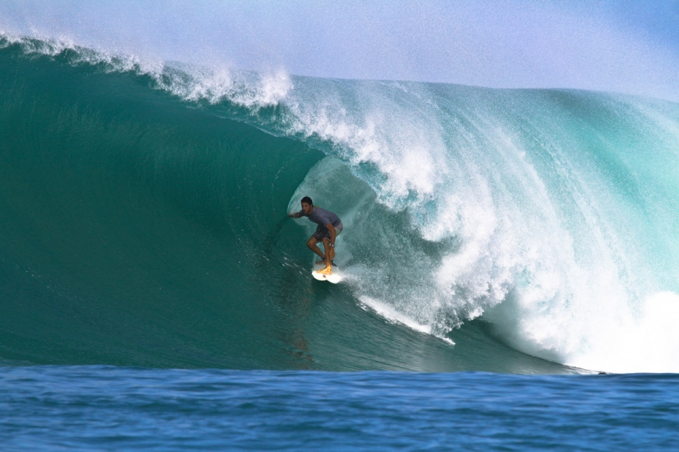 Unknown surfer scores one of the slabs of the swell.