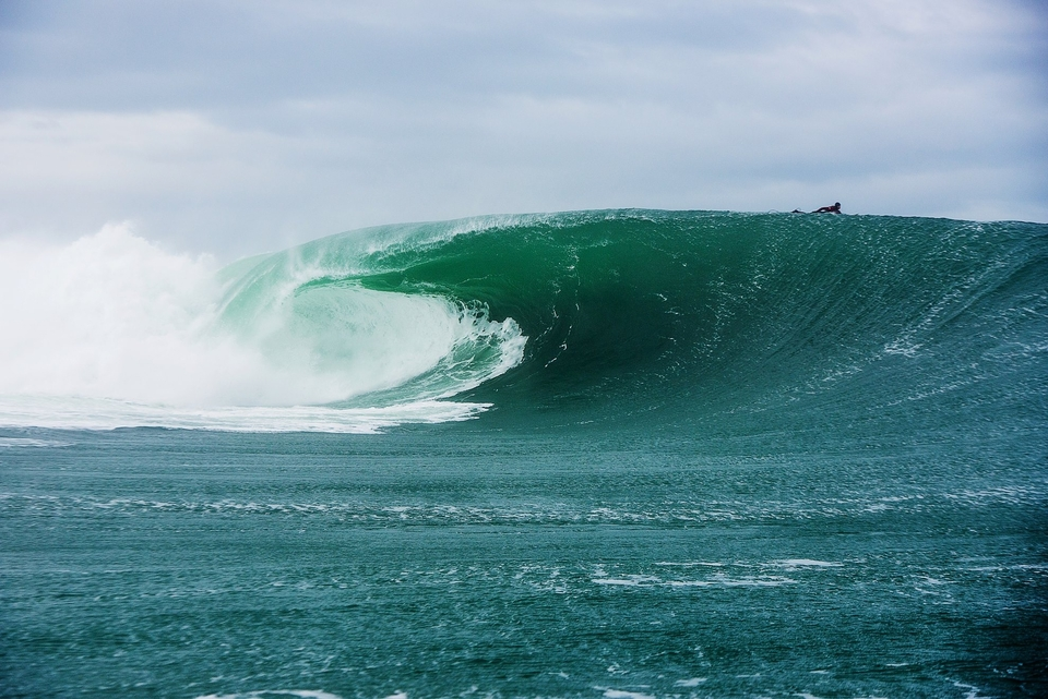 Tom Butler paddles over a backless Mully wall.
