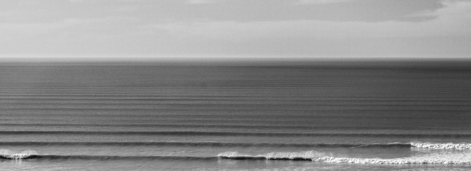 Corrugated lines: Swell marches relentlessly towards the land, seeking some endless point on which to unleash their momentum. With 1000km of untamed, sparsely populated coastline, most will explode unseen and untouched by the cut and thrust of glass and fin, unblemished by the caress of fingertips on their silken faces.