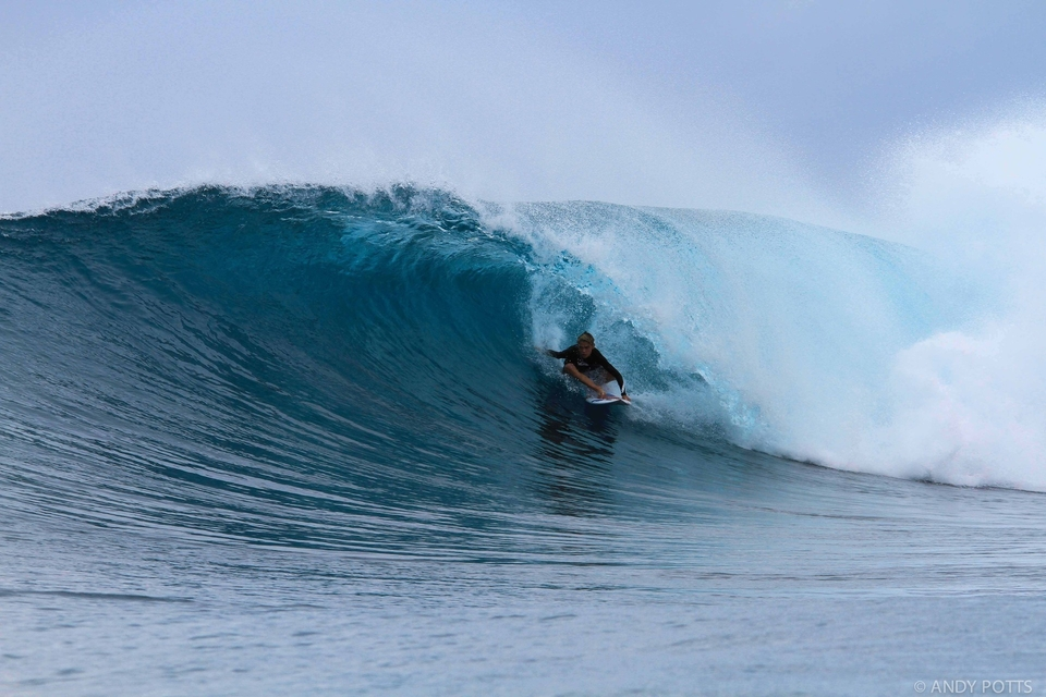 Ryder Guest on rail above some shallow reef at HT's   Wave.