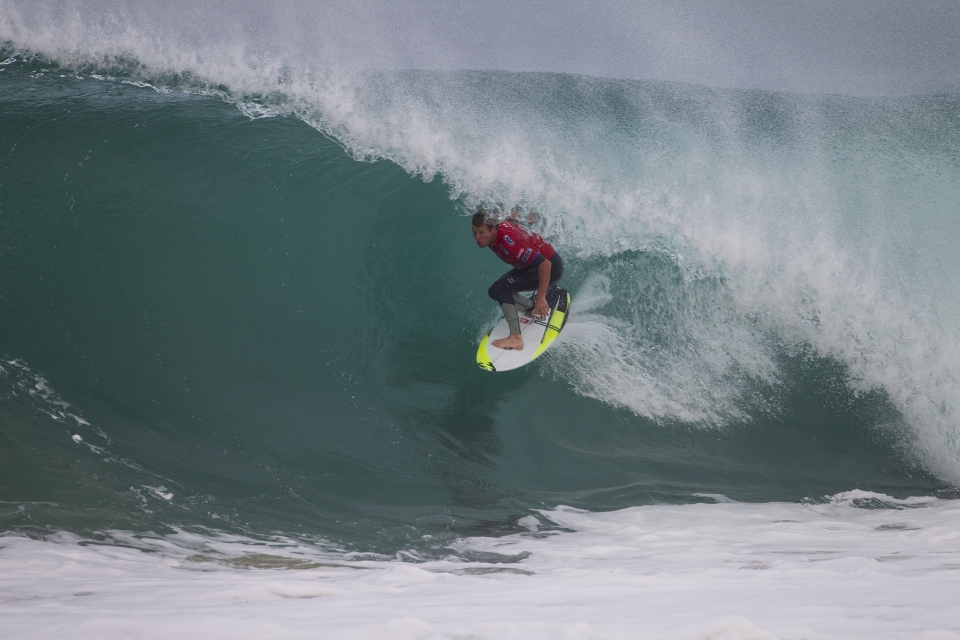 Taj Burrow took down Alejo Muniz in the first heat of the morning. The momentum from his Trestles win shows no signs of dissipating.