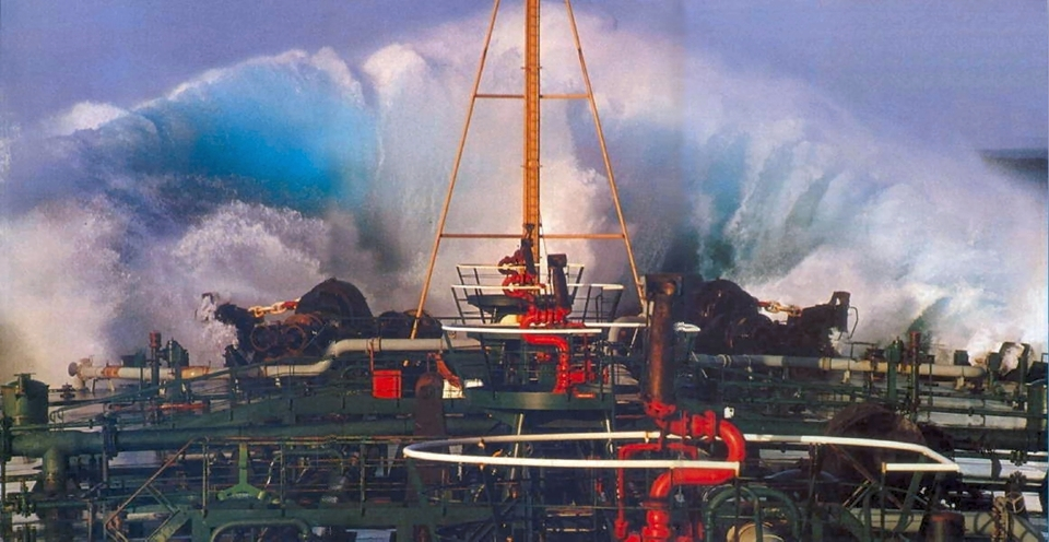 A giant wave breaking over the bow of the Esso Nederland II in the Agulhas Current.