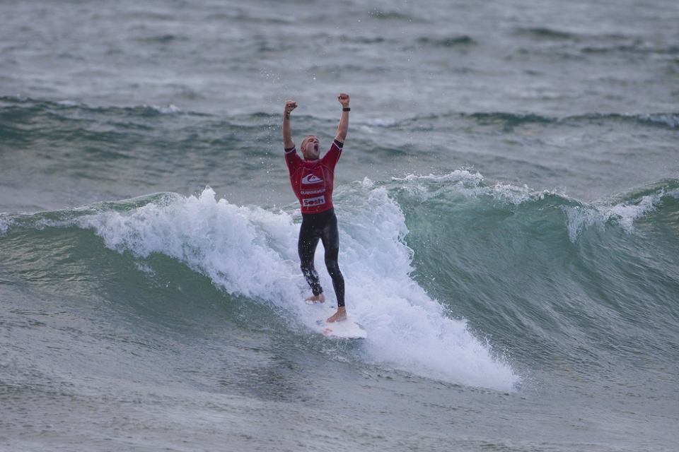 Mick Fanning and the winning blue water fist pump.