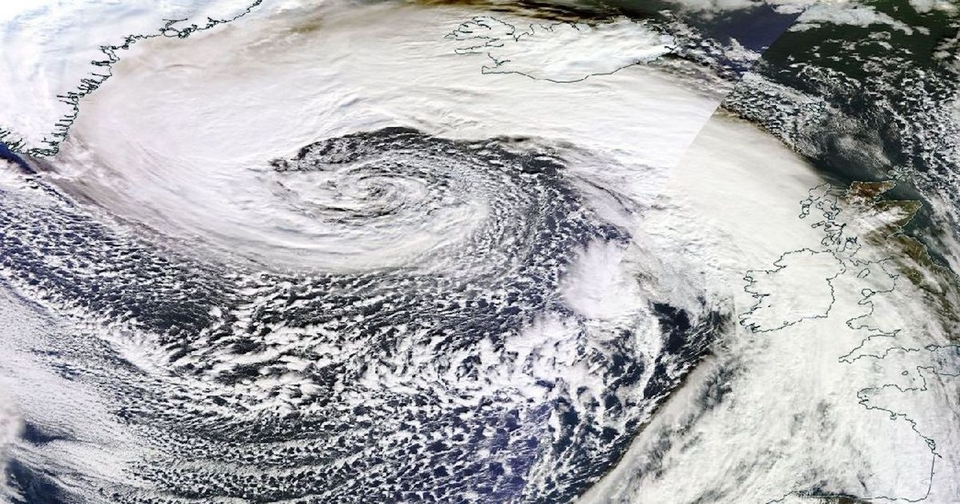 The view from space of a giant storm covering almost 2000 miles of ocean in the North Atlantic and producing huge waves.