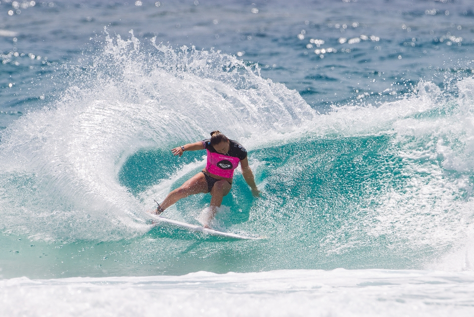 Carissa Moore is a bang tidy surfer, perfectly illustrates with this power punch.